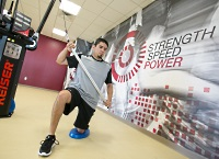 UW Health Performance Speed Strength training: Man doing weight training