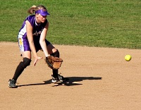 UW Health Sports Performance Preseason Softball training: Girl fielding a softball