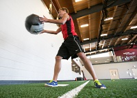 UW Health Sports Performance Developmental Speed Strength training: Young man working with a medicine ball