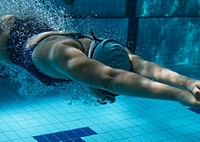 UW Health Sports Performance swimming training: Woman swimming in a pool