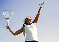 UW Health Sports Performance Preseason tennis training: Woman serving a tennis ball