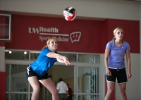 UW Health Sports Performance Preseason volleyball training: Girls hitting a volleyball