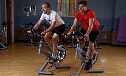 UW Health Sports Medicine Fitness Center: Two men biking