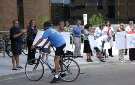 Dan Lester, on bicycle, with well wishers