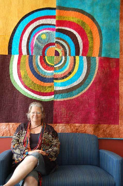 Cherie St. Cyr, with one of her art quilts