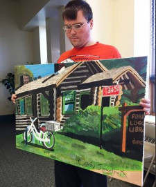 Cody Spurlock holding Forest Lodge Library