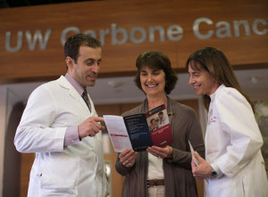 Jane DeShaw with doctors Ahmed Afifi and Heather Neuman at UW Carbone Cancer Center