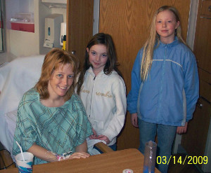 Before: Even though she was given a grim diagnosis, Shelly Casey, wanted to fight because her children were so young. Here she is just after liver ablation surgery at UW Hospital with daughters Shea, left, and Quinn. Son Cade, who was 4 at the time, is not shown.