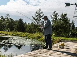 UW Carbone Cancer Center clinical trial participant Buck Parker fishes at his farm.