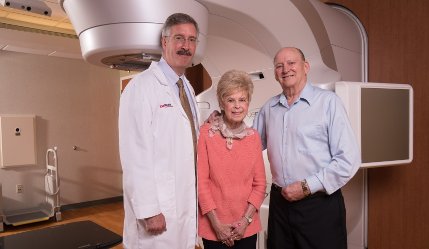 Cancer patient Robert Comyne (right) with Dr. Greg Cooley (left) and wife Diane.