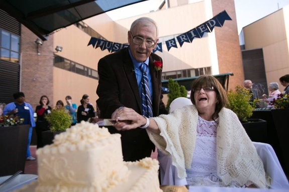 Bob and Denise cut their wedding cake outside of University Hospital.