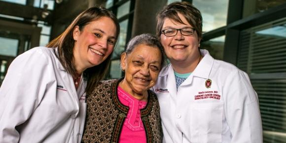 Eloisa Torres-Flores (center) with UW Carbone Cancer Center doctors Emily Winslow (left) and Noelle LoConte (right).