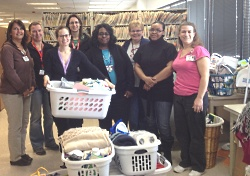 "Health Information Management staff prepare ""Welcome Home"" baskets for delivery to Porchlight."