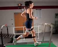 An athlete is videotaped using the 8-camera motion analysis system to assess running mechanics after injury