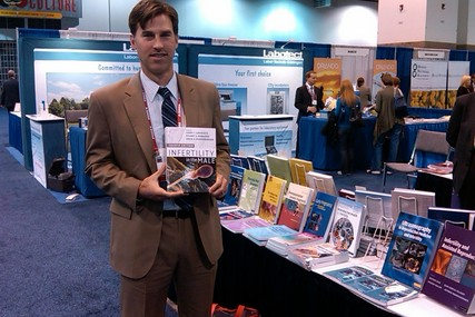 Dr. Dan Williams displays the newest edition of the textbook, Infertility in the Male, which is considered to be the most prominent resource for information about male reproductive medicine. Dr. Williams authored the chapter on Techniques of Sperm Retrieval.