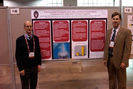 Drs. Dan Lebovic (left) and Dan Williams stand in front of their research that was presented at the annual meeting. They determined that educating oncologists about the negative effects of cancer and cancer treatment on a man's fertility resulted in an immediate increase in the utilization of sperm cryopreservation by these men prior to treatment. Co-authors not pictured include Drs. Charles Bormann, Julianne Zweifel, Sana Salih and Lauren Wagner.