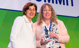 Mary Evers Statz, right, from UW Health accepts the Better Buildings Challenge Award from Maria Vargas of the U.S. Department of Energy.