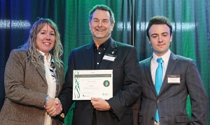Tom Eggert, Executive Director of the Wisconsin Sustainable Business Council (center), presented the Green Masters award to Mary Evers Statz (left) and sustainability specialist, Maximilian Christman (right).