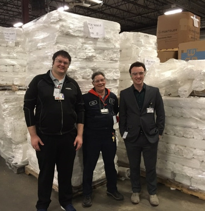 Joshua Churchill and Robin Werner from Environmental Services tour Uniek in Waunakee with Maximilian Christman from the Sustainability Program. Uniek is able to take the Styrofoam generated at University Hospital and turn it into picture frames and other products.