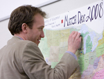 UW School of Medicine and Public Health medical student marks his match on a map of the U.S.