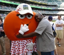 Dottie Donor Dot gets a hug from that guy who repossesses beer at Miller Park