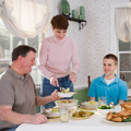 Parents and son eating meal; Family Meal Key to Good Health