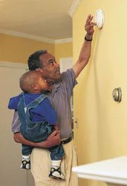checking smoke detectors, fire prevention week