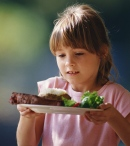 Girl holding plate; UW Health's Pediatric Fitness Clinic Shares How Parents Help Shape Food Attitudes