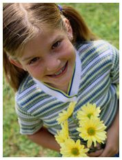 girl with daisies; Getting the Jump on Childhood Asthma