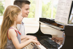Kids playing the piano