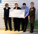 Deb Amesqua, Peg Van Bree, Mike Savage, Karen Lund receive donation check