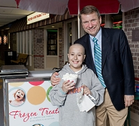 Dr. Robert Lemanske and patient in front of frozen treats cart