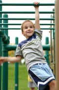 Boy on Monkey Bars; UW Health Pediatric Fitness Initiative's Summer Fitness Contract Helps Kids Stay Fit