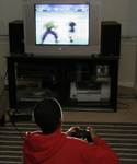 Teen playing video game