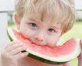 boy eating watermelon; UW Health's Pediatric Fitness Clinic Helps Kids Make Healthy Choices