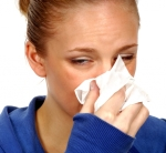 Woman blowing nose; Your Home Can Be a Source for Allergies According to Physicians at the UW School of Medicine and Public Health