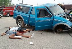 A young man and woman portray the aftermath of a reenacted drunk driving collision at Middleton High School.