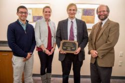 Doug Dulli, MD, receives his Community Service Award from Bob Golden, Dean of the UW School of Medicine and Public Health (view more photos below)