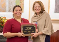 Mary Vasquez receives her Community Service Award from Juli Aulik, UW Health Director of Community Relations (view more photos below)