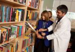 Wisconsin's First Lady Jessica Doyle and Dr. Dipesh Navsaria Cutting the Ribbon at the New Inpatient Library at the American Family Children's Hospital in Madison, Wisconsin