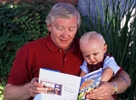 Man reading to his grandson
