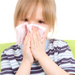 Girl holding handkerchief; Tips for Treating Nose Bleeds