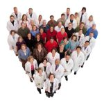 People grouped in the shape of a heart; Four of the five heart transplant recipients and their health care team, UW Health Transplant Program