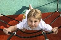 A kid climbing a rope ladder
