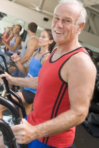 Man happily exercising on a Stairmaster