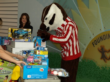 Bucky Badger tests out some of the toys before they're handed out to patients at American Family Children's Hospital.