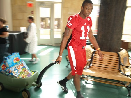 Badgers sophomore defensive lineman David Gilbert heads out with a wagon loaded with toys.