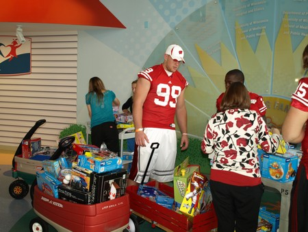 J.J. Watt checks out some of the toys and talks strategy with teammate Jay Valai.