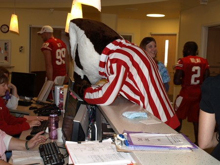"Bucky Badger tries to ""help"" at a nurse's station at American Family Children's Hospital."