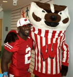 UW football player Jay Valai and Bucky Badger teamed up to hand out toys to patients at American Family Children's Hospital thanks to the Greater Bucky Open